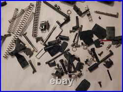 Glock Model 23 box, holster, magazine parts, springs triggers slide release MORE